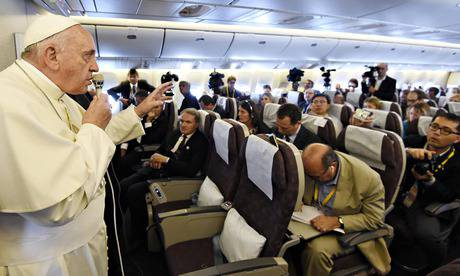 Pope Francis gestures while speaking to journalists aboard a flight from South Korea to Italy, 18 August 2014