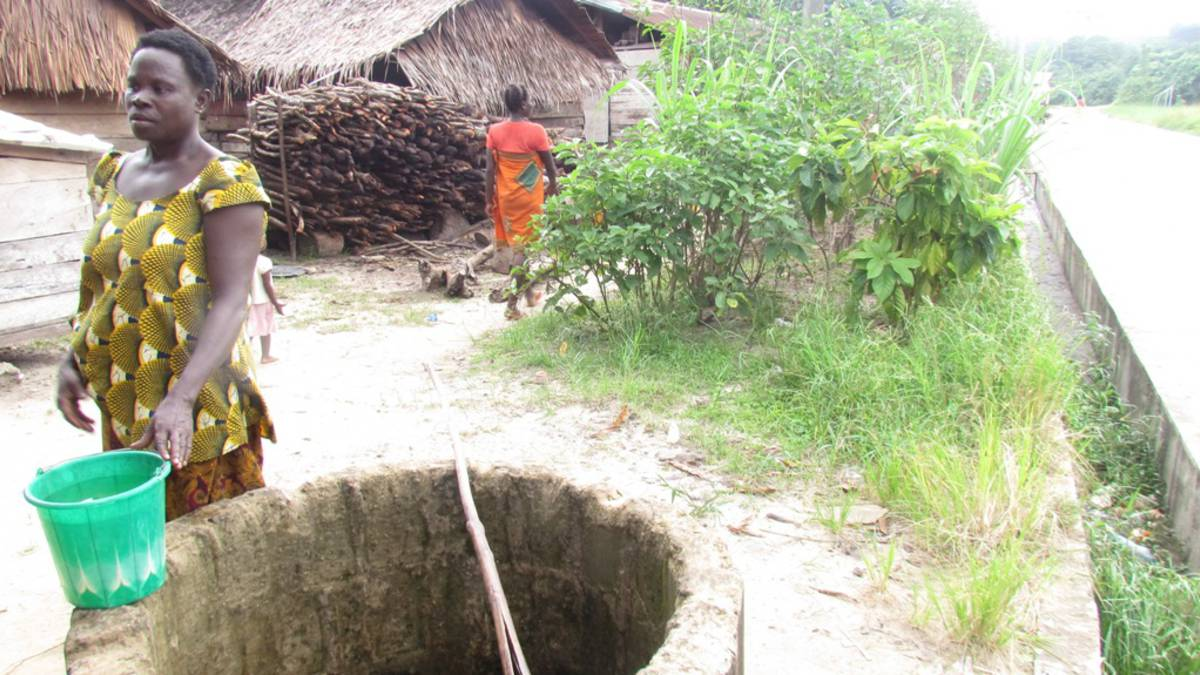 Woman leaving after fetching water from well