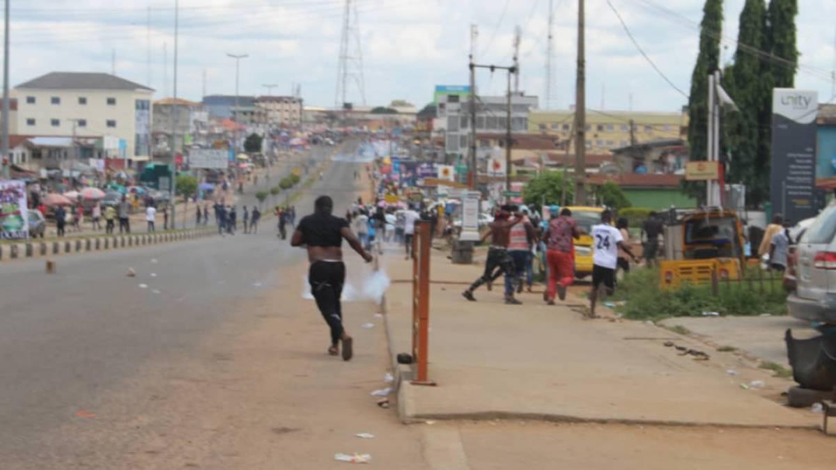 Students fleeing after being teargassed by Police